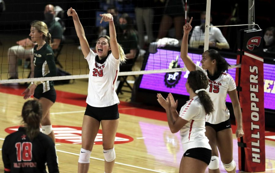 WKU Volleyball's Kate Isenbarger (20) celebrates a block with her teammates to add to the Hilltoppers lead in the set Nov. 7, 2020.