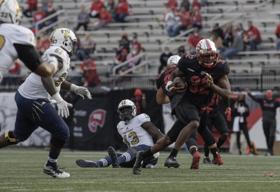FIU+tight+end+Rivaldo+Fairweather+%2813%29+sits+on+the+field+as+Hiltopper+linebacker+Eli+Brown+runs+to+make+a+touchdown.+WKU+defeated+FIU+38-17.
