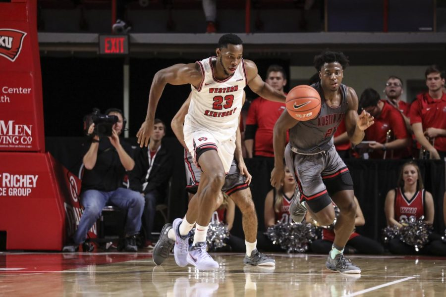 Charles Bassey charging up the court during the 2019-20 regular season.