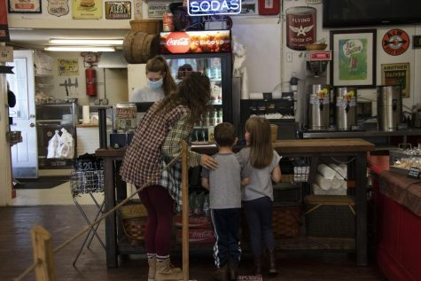 Isabelle Graves checks out at Boyce General store with children Noah and Ella Glass. They stopped in the store for a bite to eat while Noah and Ella Glass' parents were at work.