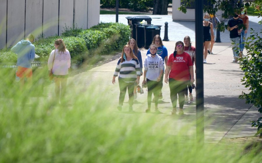 A group of WKU students walk across campus on Aug. 22, 2020. Masks are required at all times in public on campus.