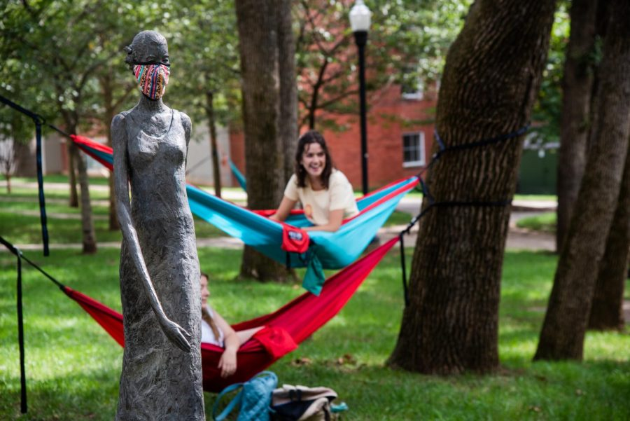 Audrey Plescia, a junior at WKU majoring in theatre and sociology, suspends in her hammock near Centennial Mall on September 5. Fewer students seem to be choosing to relax and socialize in public spaces on campus. Even so, sightings of WKU students suspended in hammocks around campus remains fairly common.