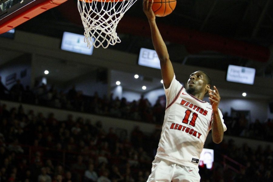 Junior guard Taveion Hollingsworth (11) goes up for a layup during theWKU Hilltoppers' 91-84 win over the Marshall Thundering Herd on Saturday, Jan. 25 in Diddle Arena.