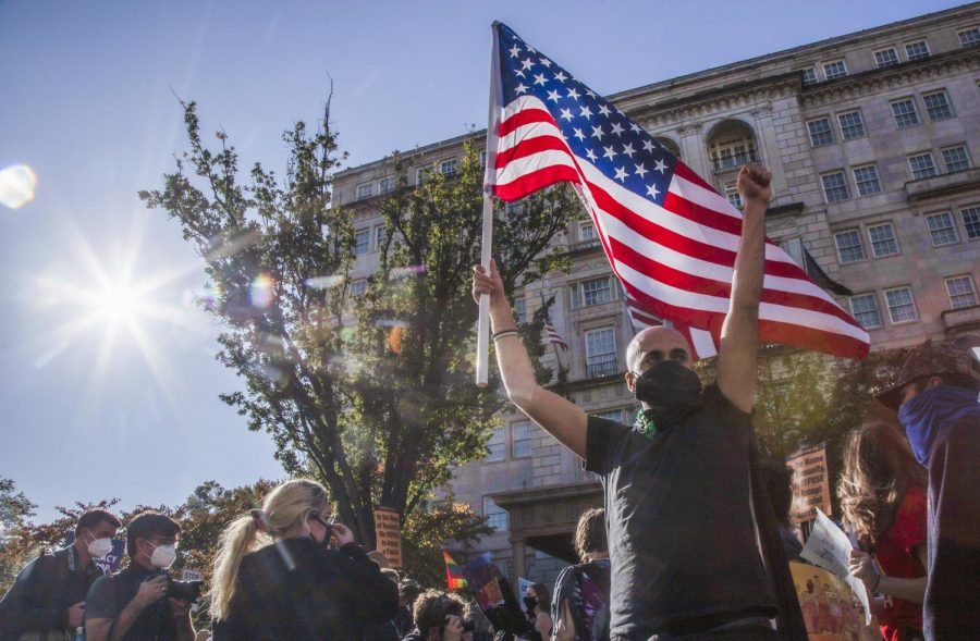 Protesters march down Black Lives Matter Plaza coming from McPherson Park for the Count Every Vote rally that ended with an organized march on November 6, 2020 in Washington, D.C.