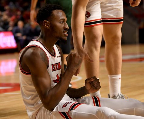 WKU guard Josh Anderson (4) celebrates after making a basket at the Charlotte v WKU basketball game on Feb 22, 2020 in Diddle Arena. The Hilltoppers were defeated 72-20.