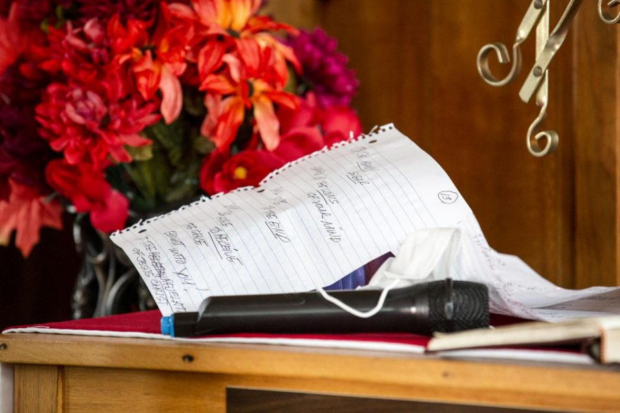 Clarence Tapp's mask and sermon notes sit on the communion table