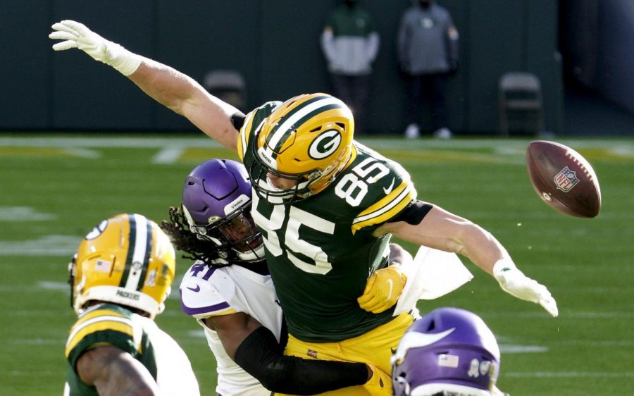 Green Bay Packers tight end Robert Tonyan (85) is not able to come down with a 4th and 9-yard pass from quarterback Aaron Rodgers (12) in the 4th quarter. Tonyan was defended by Minnesota Vikings free safety Anthony Harris (41). The Green Bay Packer hosted the Minnesota Vikings at Lambeau Field Sunday, Nov., 1, 2020.