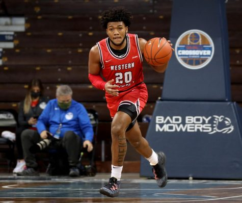 Sioux Falls, SD - Nov. 25: Dayvion Mcknight #20 of the Western Kentucky Hilltoppers brings the ball up court against the Northern Iowa Panthers during the Bad Boy Mowers Crossover Classic at the Sanford Pentagon.