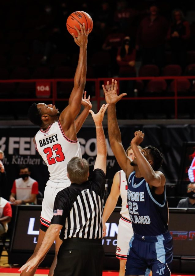WKU Center Charles Bassey (23) wins the tip-off against Rhode Island Center Makhel Mitchell (22). The Hilltoppers played the Rhode Island Rams on Sunday, Dec. 13, with Western narrowly beating Rhode Island 68-65.