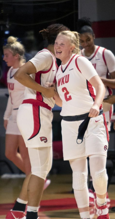 Freshman+Jenna+Kallenberg+%282%29+celebrates+a+win+with+her+teammate+after+the+game+against+the+Bellarmine+University+Knights+on+Wed.+Dec.+16%2C+2020.+The+Lady+Toppers+won+82-49.