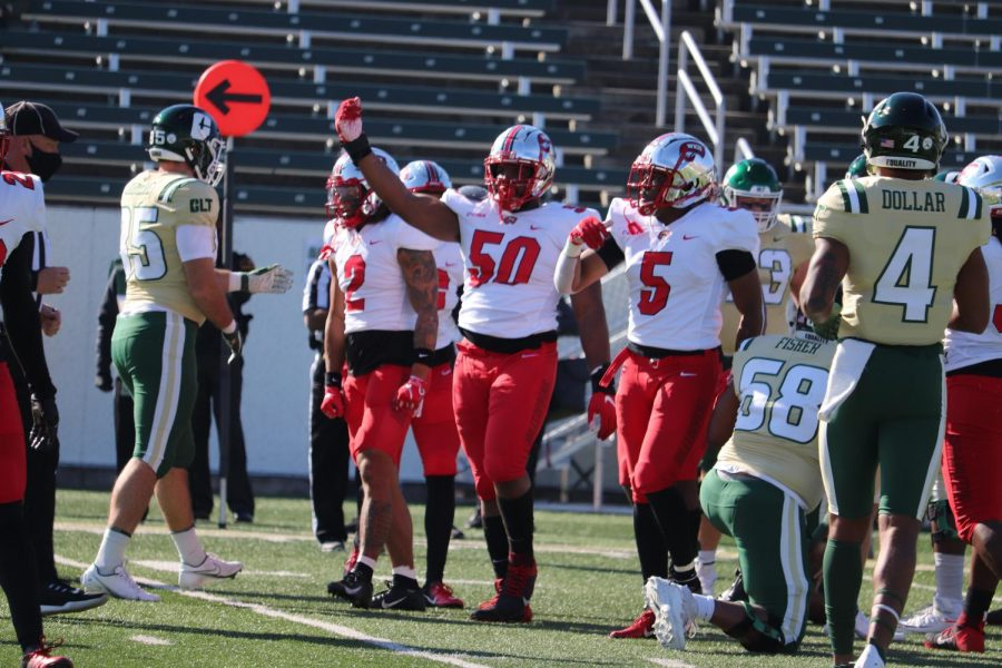 Redshirt+freshman+defensive+tackle+Ricky+Barber+%2850%29+signals+a+stop+on+defense+against+Charlotte+on+Dec.+6%2C+2020.+WKU+went+on+to+win+37-19+versus+the+49ers+in+the+2020+regular+season+finale.%C2%A0