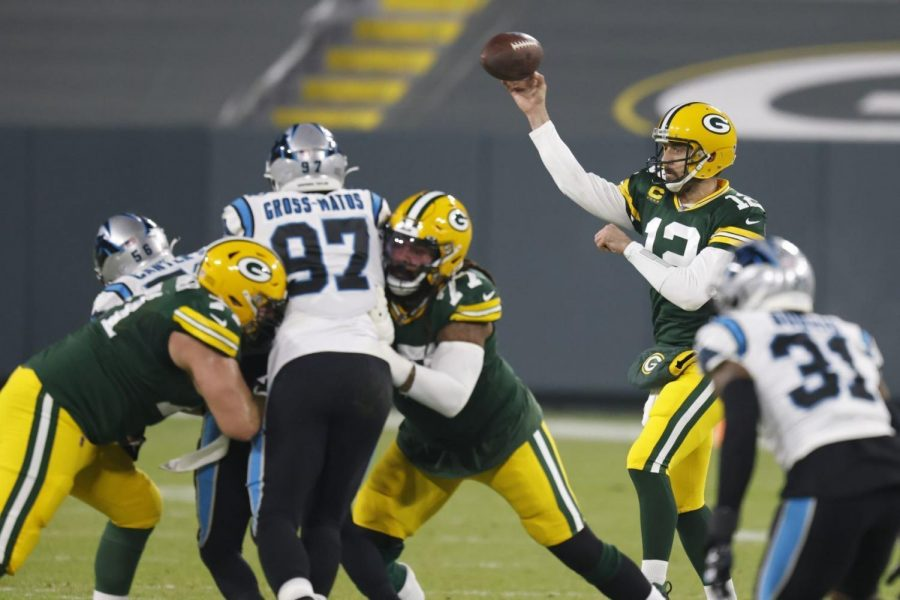 Green Bay Packers' Aaron Rodgers throws during the first half of an NFL football game against the Carolina Panthers Saturday, Dec. 19, 2020, in Green Bay.
