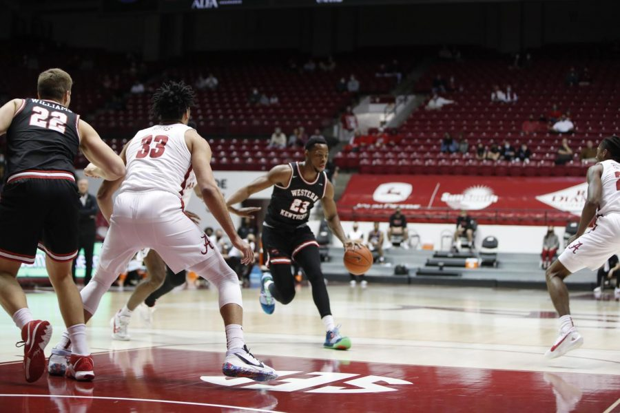 Junior Charles Bassey driving the basket at Alabama on Dec. 19, 2020. The Hilltoppers went on to win 73-71 over the Crimson Tide.