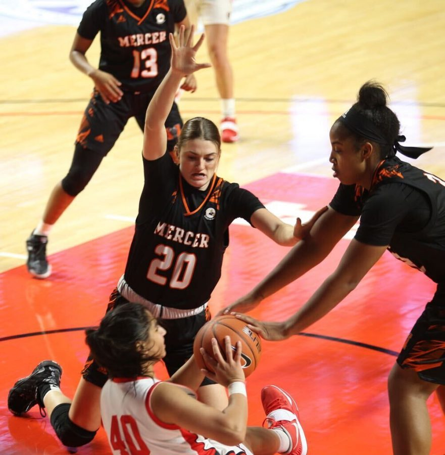 Mercer+College+Bears+Junior+Forward+%E2%80%99s+Sierra+Vatow+%28center%29+and+Jaron+Dougherty+%28right%29+battle+Western+Kentucky+University+Junior+Guard+Meral+Abdelgawad+for+possession+of+the+ball+during+their+game+on+Dec.+18%2C+2020+in+Diddle+Arena+in+Bowling+Green%2C+KY+where+Mercer+won+71-54.