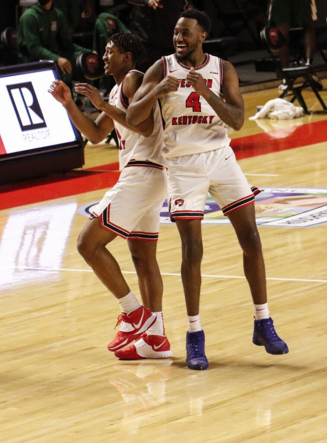 Senior guard Josh Anderson (4) shoulder bumping freshman guard Kylen Milton (1) in the 96-69 win over Mississippi Valley State on Dec. 6, 2020. This was the teams home opener for the 2020-21 regular season.