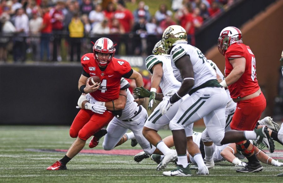 WKU%E2%80%99s+Ty+Storey+%2811%29%2C+runs+with+the+ball+away+from+the+Charlotte+49ers+during+the+second+quarter+of+the+game+on+Saturday%2C+October+19%2C+2019.+Hilltoppers+defeated+Charlotte+with+a+final+score+of+30-14.