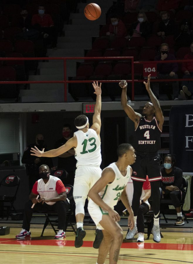 Western Kentucky University guard Josh Anderson (4) attempts a three pointer during Friday nights game against Marshall University in Diddle Arena on Jan. 15, 2021. The WKU Hilltoppers defeated the Marshall Thundering Herd 81-73.