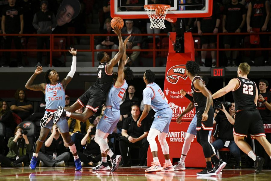 WKU guard Josh Anderson (4) leaps over defenders to make a basket during the basketball game between La. Tech and WKU on February 6, 2020 in Diddle Arena. WKU won 65-54.