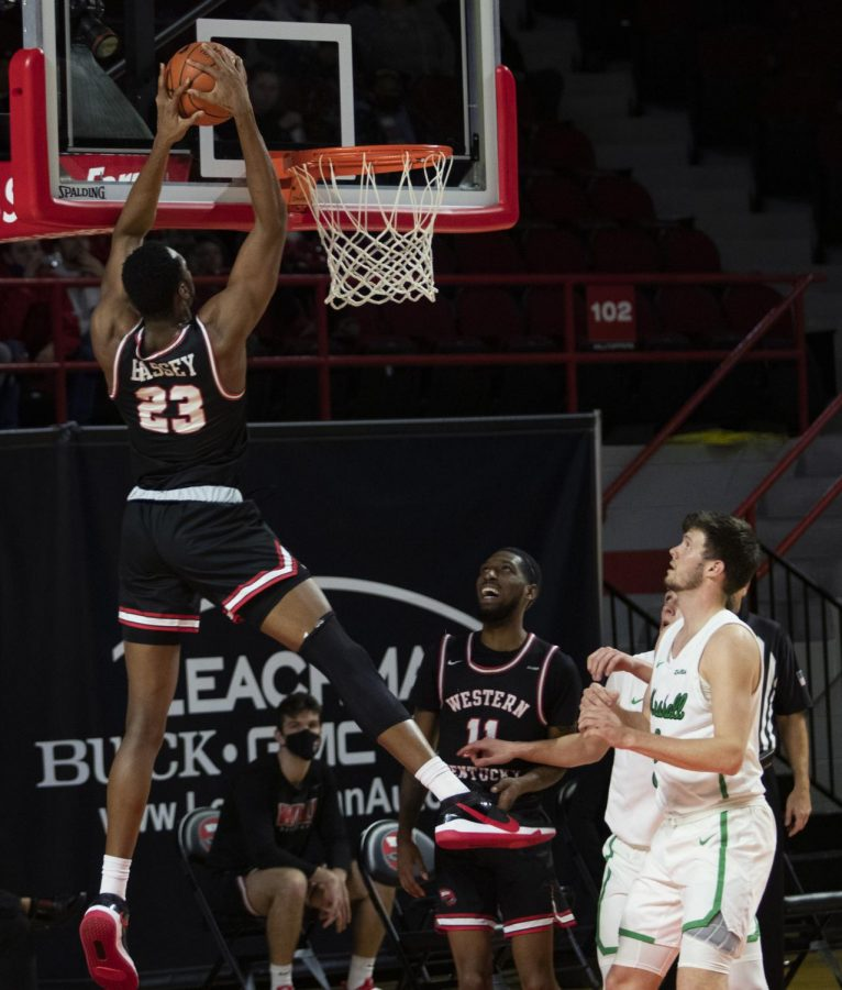 Western Kentucky University junior Charles Bassey (23) attempts to dunk the ball during Friday nights game in E.A. Diddle Arena on Jan 15, 2021. The WKU Hilltoppers defeated the Marshall University Thundering Herd 81-73.