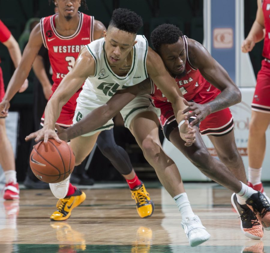Redshirt senior Jordan Shepherd (left) and senior Josh Anderson (right) fight for a loose ball in the first Conference USA matchup of the 2020-21 season. WKU came out on top 67-63 over the 49ers.