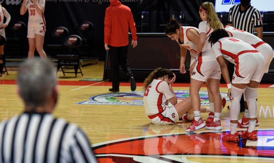 Raneem+Elgedawy+%2815%29%2C+forward+for+the+Lady+Toppers%2C+sits+on+the+court+after+nearly+getting+injured+during+WKU%E2%80%99s+game+against+the+Middle+Tennessee+State+University+Blue+Raiders.+WKU+fell+to+MTSU+75-65.