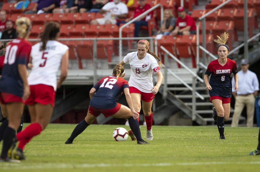 WKU midfielder Ambere Barnett (15) dribbles the ball upfield agents Belmont during the season opener at the WKU Soccer Complex on Thursday, Aug. 22, 2019.