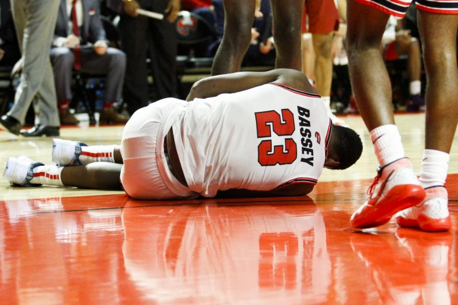 WKU center Charles Bassey (23) goes down after sustaining a leg injury in the second half. The Hilltoppers defeated the Razorbacks 86 - 79 in Diddle Arena on Saturday, December 7, 2019.