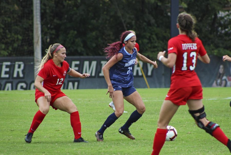WKU junior Avery Jacobsen (12) looks to take possession on the ball from ODU junior Morgan Hall (21) during the game at the WKU Soccer Complex on Oct. 6, 2019. Old Dominion shut out the Lady Toppers 3-0.