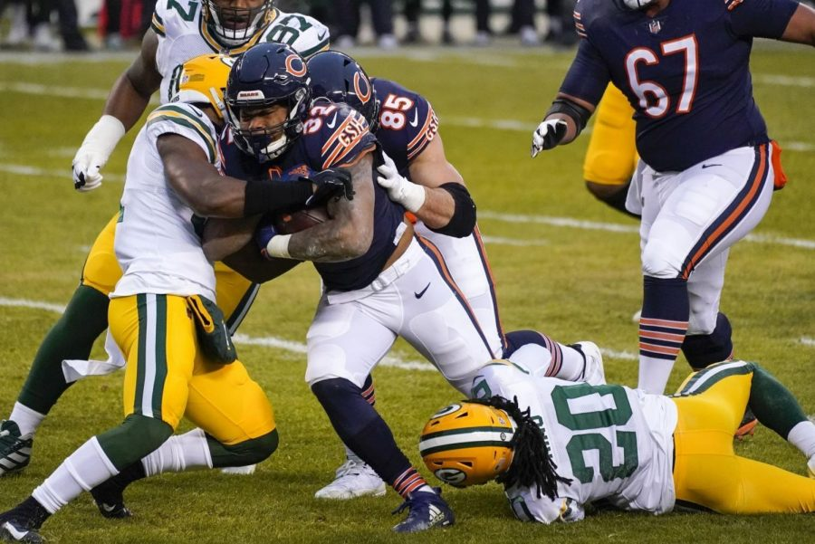 Chicago Bears' David Montgomery is stopped on a run during the first half of an NFL football game against the Green Bay Packers Sunday, Jan. 3, 2021, in Chicago.