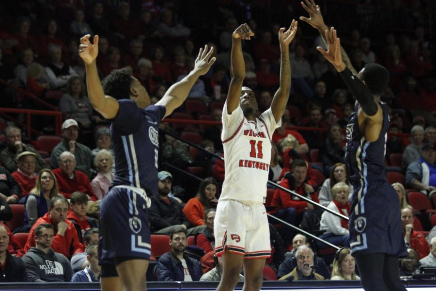 Junior guard Taveion Hollingsworth (11) pulls up for a contested 3-pointer late in the shot clock during the WKU Hilltoppers' 71-69 comeback win over the Old Dominion Monarchs on Thursday, Jan. 16 in Diddle Arena.