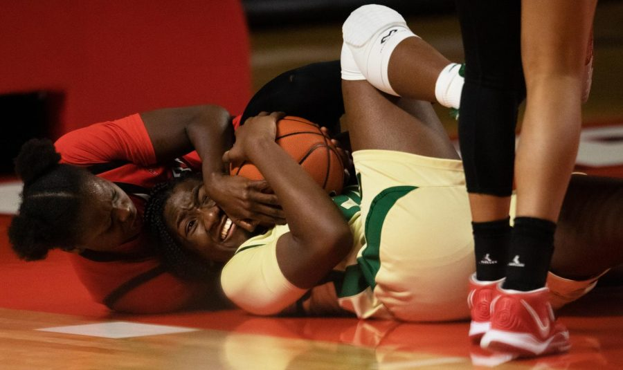 Western+Kentucky+university+lady+Hilltoppers+fought+a+tough+battle+against+the+Charlotte+49ers+as+the+lady+Hilltoppers+as+western+Kentucky%E2%80%99s+Fatou+Pouye+%2812%29+and+Charlotte%E2%80%99s+Molina+Williams+%2824%29+scrap+for+the+loose+ball.+Lady+Hilltoppers+would+go+on+the+pick+up+the+win+65-64.