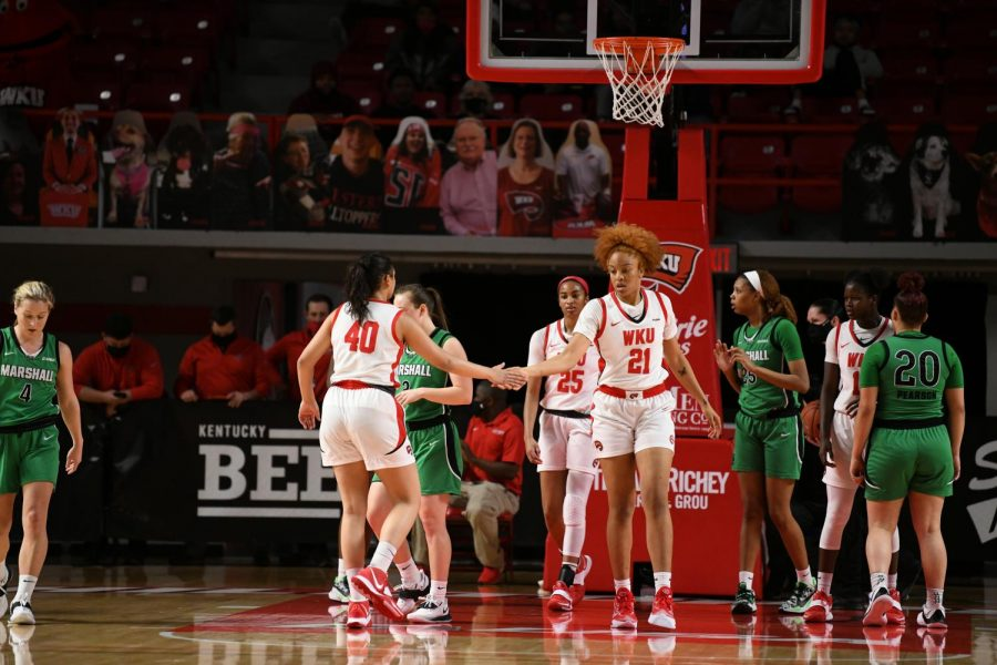 Junior Meral Abdelgawad (40) showing support to redshirt freshman Tori Hunter (21) on Jan. 17, 2021 in Diddle Arena. The Lady Toppers took down Marshall 69-60 to split the series.