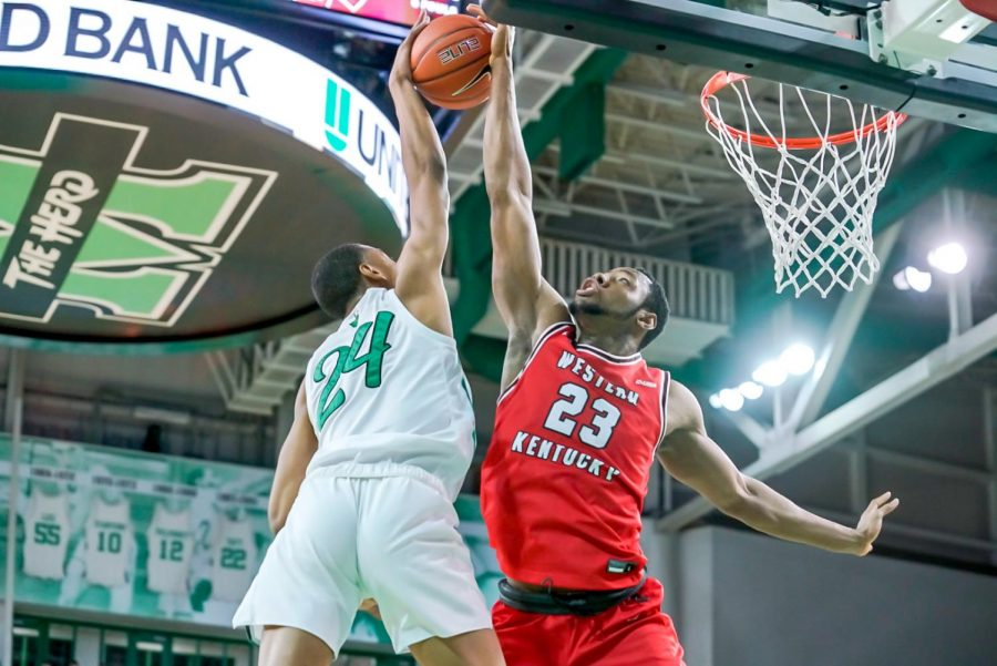 Junior Charles Bassey (23) blocking a shot against Marshall junior Taevion Kinsey (24). WKU held on for the 69-67 win on Jan. 17, 2021 over the Thundering Herd to sweep the series.
