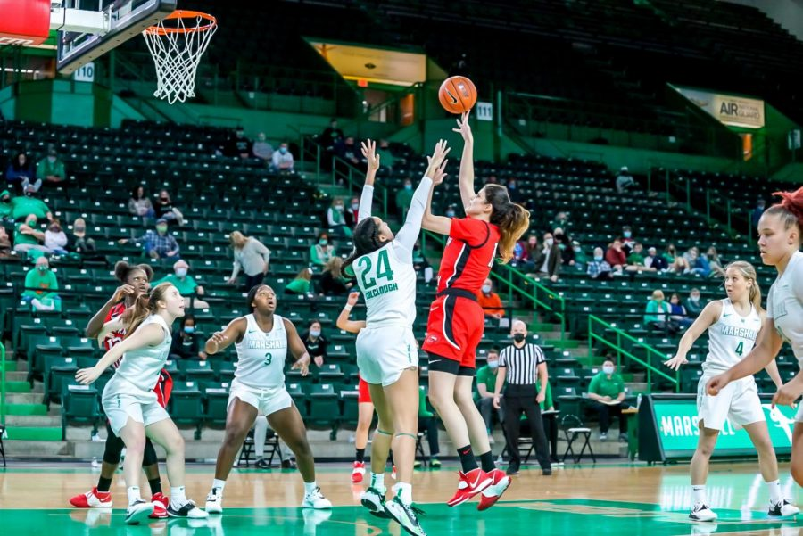 Senior RaneemElgedawy being guarded by graduate Kennedi Colclough duringher season debut on Jan. 14, 2021 against Marshall. The Lady Toppers fell 81-54 whileElgedawy had a double-double in her debut.