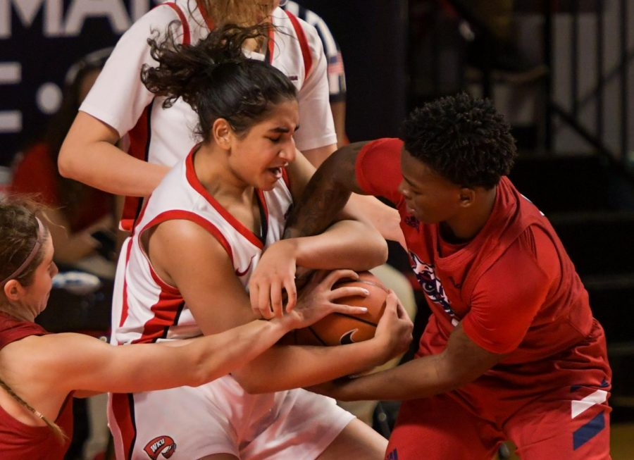 WKU guard Meral Abdelgawad (40) fights to hold onto the ball against FAU guard Iggy Allen (2) at the game at Diddle Arena on Feb. 5, 2021. WKU won 71-64.