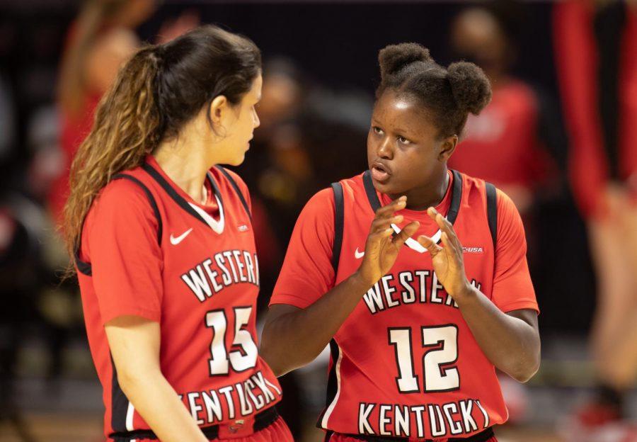 Western+Kentucky+University+Lady+Topper+Fatou+Pouye+%2812%29+communicates+the+game+plan+to+Raneem+Elgedawy+%2815%29.