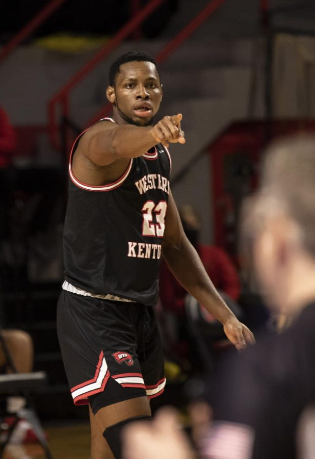 Junior Charles Bassey pointing to a teammate on Jan. 9, 2021 when WKU played LA Tech. The Hilltoppers lost 63-58 to the Bulldogs to split the weekend series.