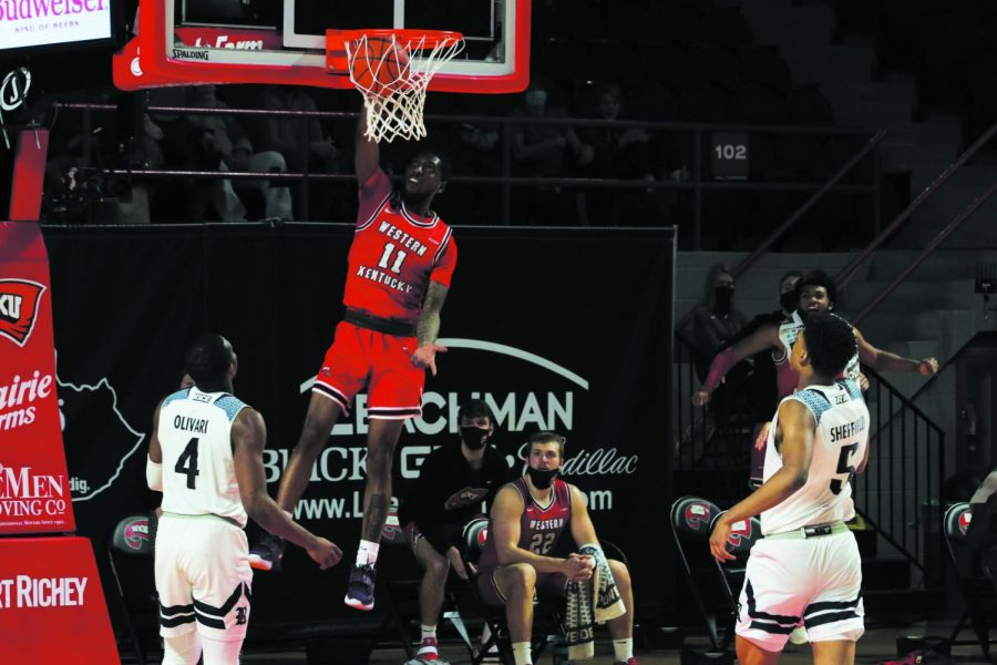 WKU senior Taveion Hollingsworth (11) dunks the ball during the game against the Rice Owls on Feb. 13 in Diddle Arena.