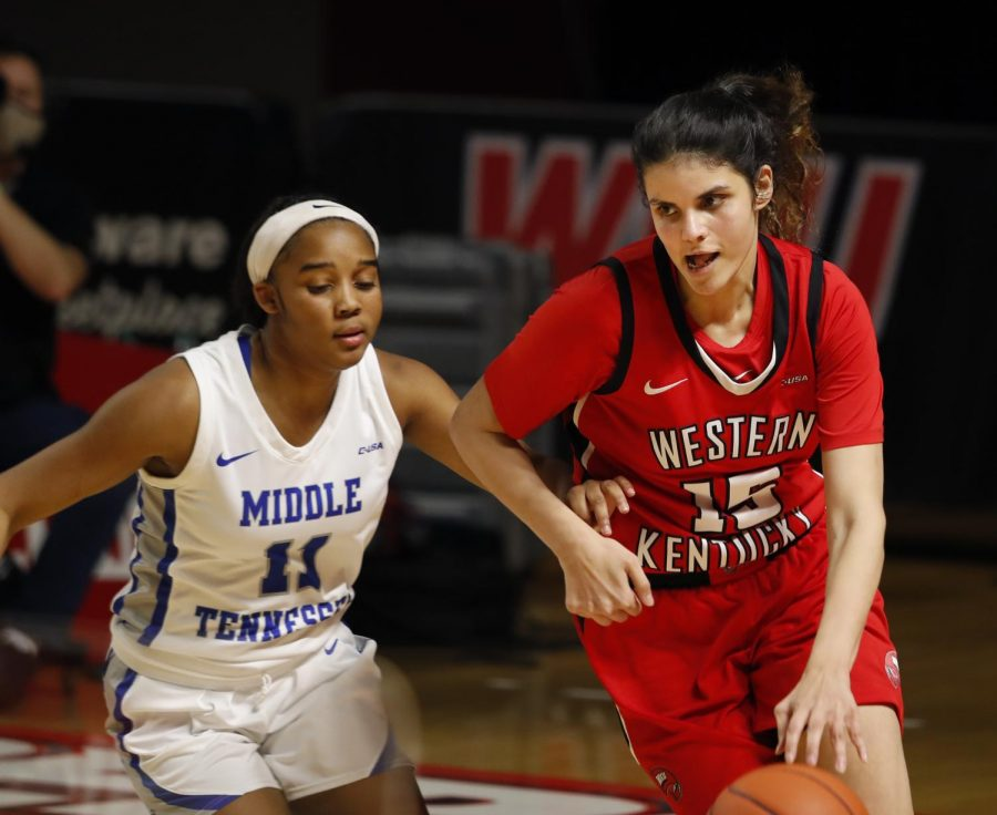 Western Kentucky University forward Raneem Elgedawy (15) dibbles the ball down the court during Saturday nights game against the Middle Tennessee State University. The WKU Lady Hilltoppers fell to the MTSU Blue Raiders 77-60.