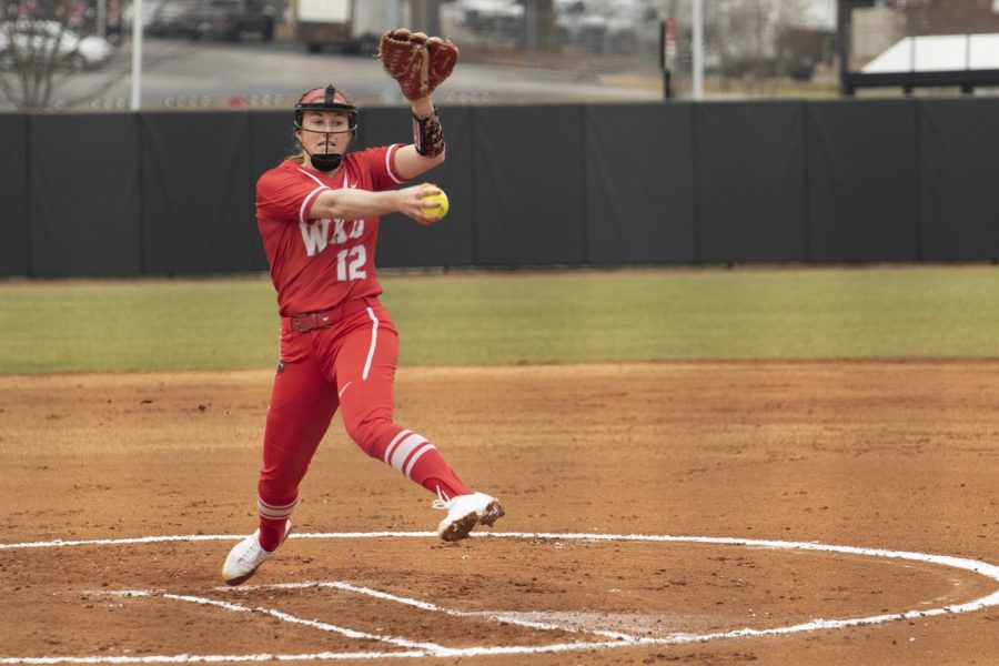 WKU+pitcher+Kelsey+Aikey+%2812%29+throws+out+a+strike+against+Indiana+state+university+on+Feb+27%2C+2021+at+the+WKU+softball+field.+The+Hilltoppers+defeated+the+sycamore+6-0+in+the+Hilltopper+Classic+to+get+their+first+at+home+victory.