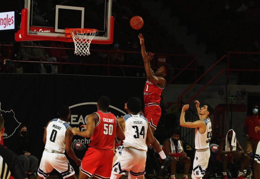 WKU freshman Kylen Milton (1) attempts a shot during the game against the Rice Owls on Feb. 13, 2021 in Diddle Arena.
