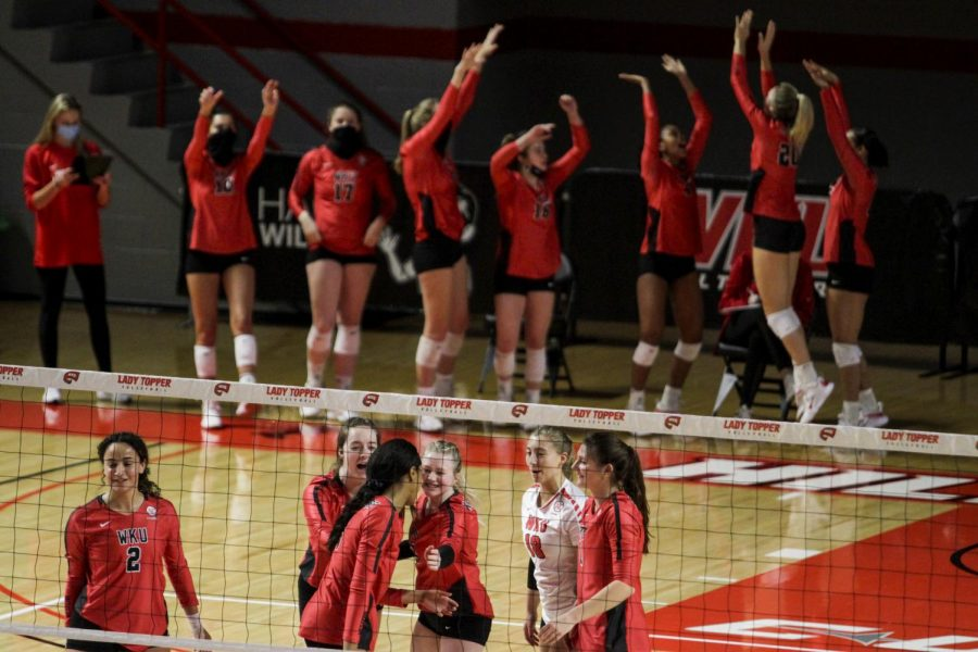 The WKU volleyball team cheers after winning a point at the game on Jan. 24, 2021. WKU won all three sets.