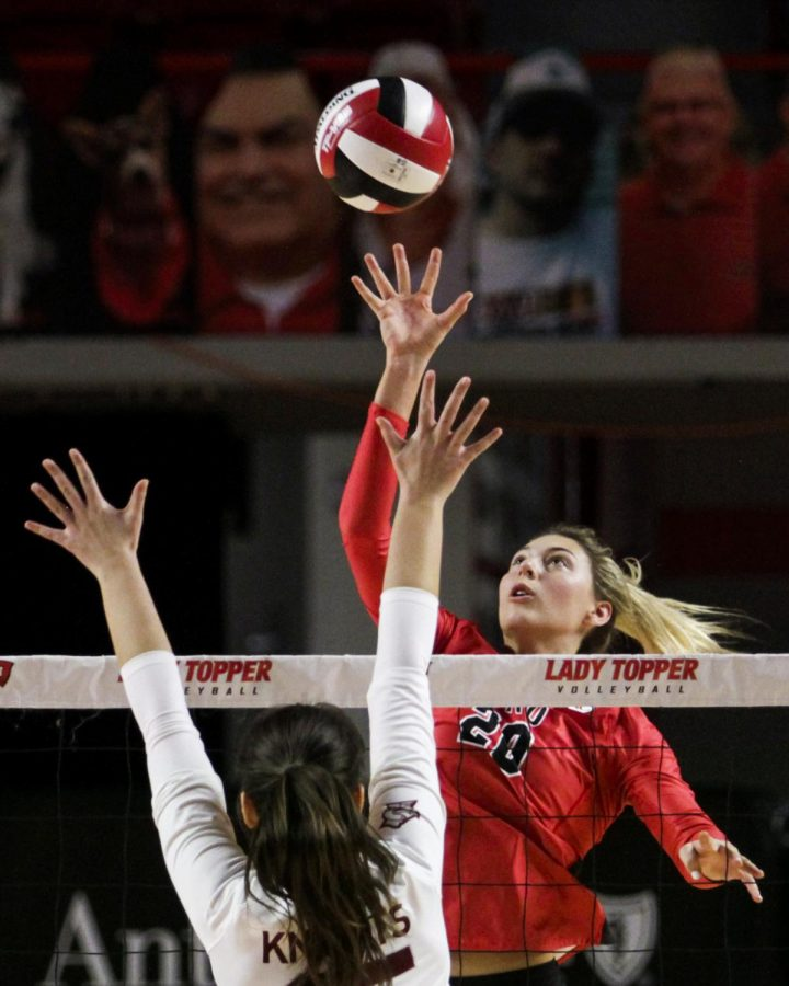 WKU+middle+hitter+Katie+Isenbarger+%2820%29+sets+the+volleyball+back+over+the+net+at+the+game+on+Jan.+24%2C+2021.+WKU+won+all+three+sets.