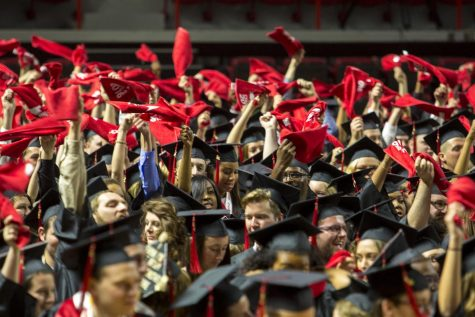 Graduates wave their red towels near the end of the Potter College of Arts & Letters and University College commencement ceremony Saturday at Diddle Arena.