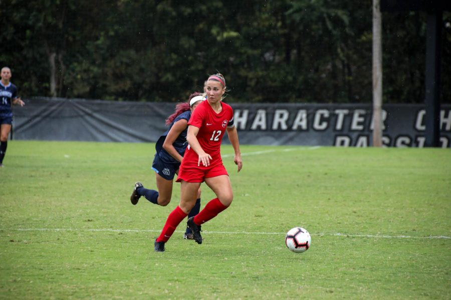 Avery Jacobsen dribbling the ball up the field against Old Dominion on Sunday Oct. 6, 2019 at the WKU Soccer Complex.