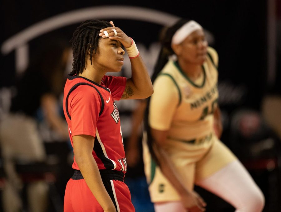 Lady Topper Myriah Haywood (00) wipes sweat from her head as she prepares for the next play.