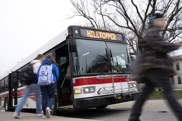 Students board the hilltopper line bus by Cherry Hall on WKU's campus.