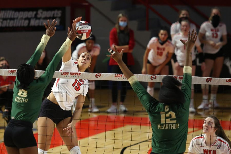 WKU senior Outside Hitter Kayland Jackson spikes the ball during a game against the University of North Carolina at Charlotte 49ers on February 21, 2021 in Diddle Arena. WKU won 3-0.