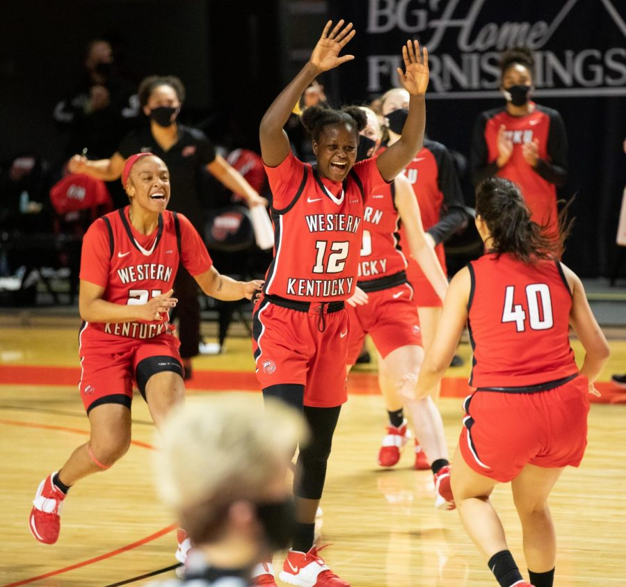 Western+Kentucky+University+Lady+Toppers+celebrate+their+one+point+win+over+the+Charlotte+Lady+49ers%3A+Tori+Hunter+%2821%29%2C+Fatou+Pouye+%2812%29%2C+Meral+Abdelgawad+%2840%29.
