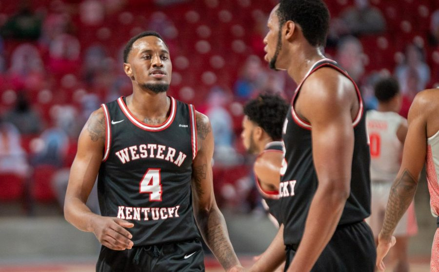 Senior Josh Anderson (4) talking with teammate Charles Bassey as WKU played at No. 12 Houston on Feb. 25, 2021. The Hilltoppers fell 81-57 to the Cougars prior to a four game homestand.
